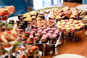 Holiday table of tempting desserts - with mindfulness and self-care you can avoid holiday weight gain